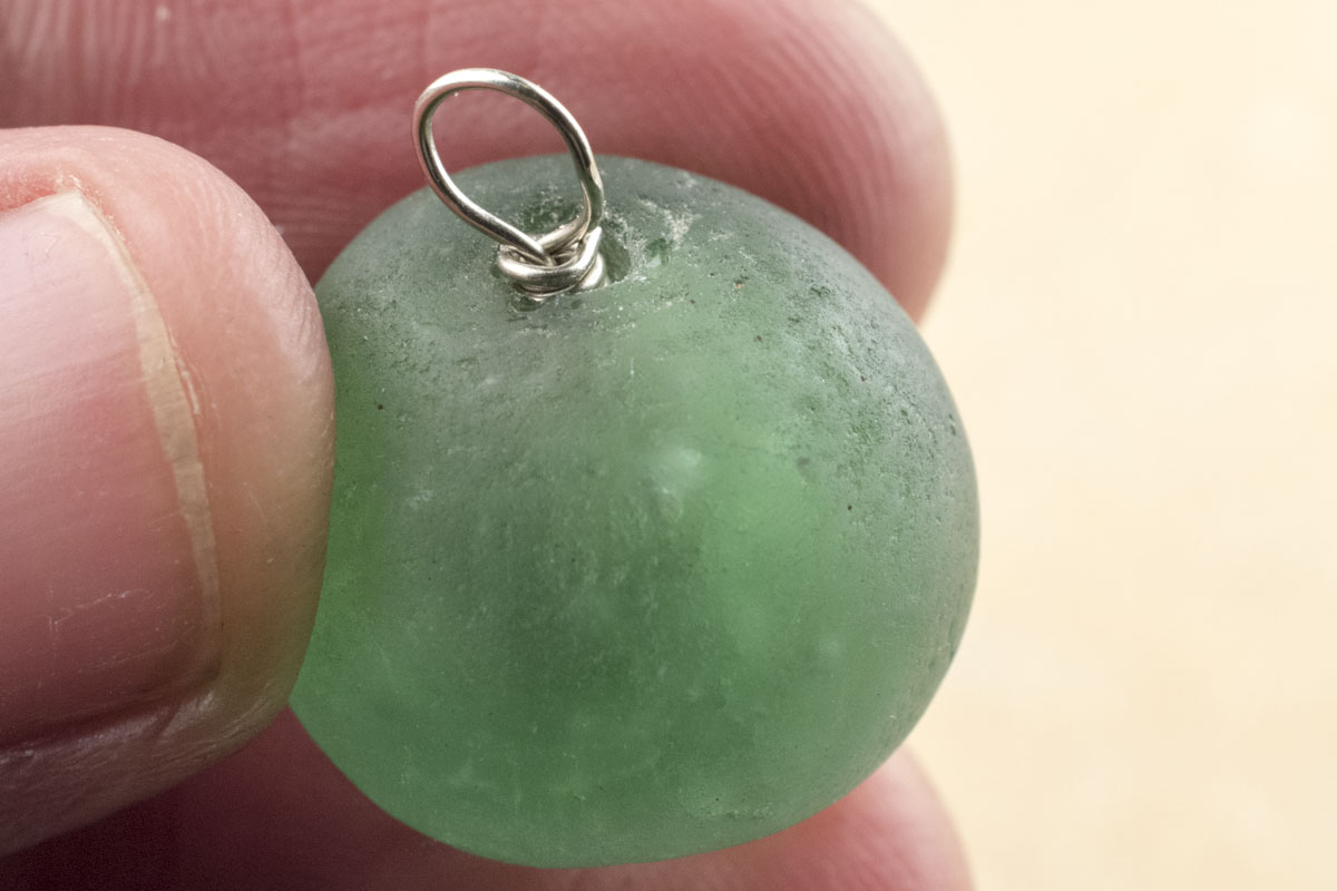 Wire wrapping with large beads with irregular and uneven surface